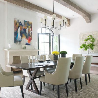 Dining room - transitional light wood floor dining room idea in New York with white walls and a standard fireplace