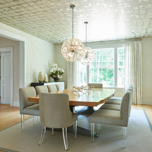 Transitional separate dining room in New York with beige walls and light hardwood floors.