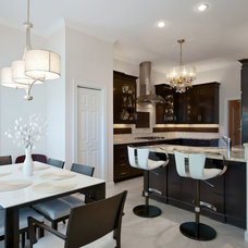 Transitional Dining Room by Cabinet Studio