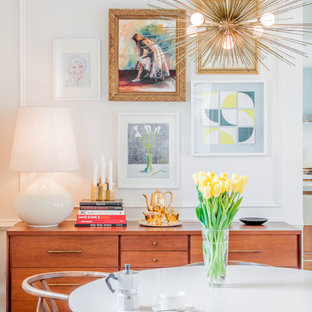 Inspiration for a transitional dining room remodel in Boston with white walls
