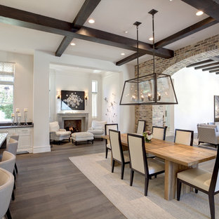 Example of a large transitional dark wood floor and white floor great room design in Dallas with white walls, a standard fireplace and a concrete fireplace