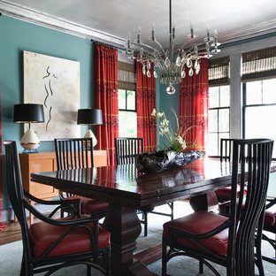 Eclectic medium tone wood floor and brown floor enclosed dining room photo in Other with blue walls