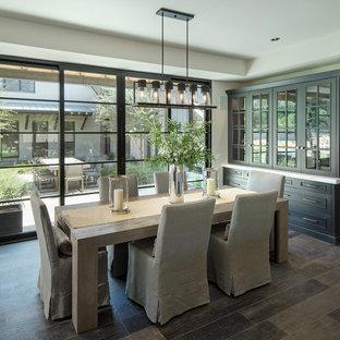 Cottage brown floor and dark wood floor dining room photo in Phoenix with gray walls
