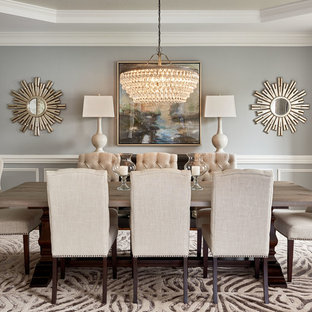 Transitional dining room photo in Charlotte with gray walls and a standard fireplace
