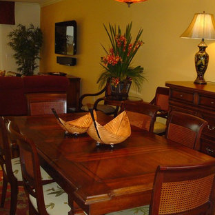 Photo of a tropical open plan dining in Hawaii with yellow walls and limestone floors.