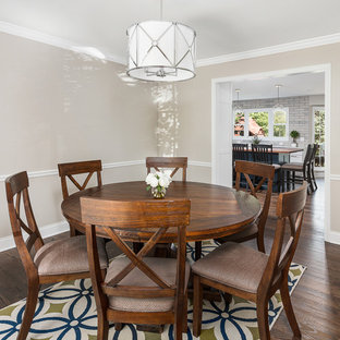 Large transitional medium tone wood floor and brown floor enclosed dining room photo in Chicago with beige walls and no fireplace
