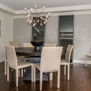 Enclosed dining room - mid-sized transitional dark wood floor and brown floor enclosed dining room idea in New York with gray walls and no fireplace