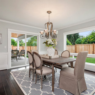 Dining room - large transitional dark wood floor dining room idea in Seattle with gray walls and no fireplace