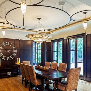 Photo of a large classic enclosed dining room in Toronto with medium hardwood flooring, brown walls and no fireplace.
