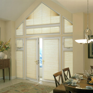 Triangular and trapezoid windows add interest to a dining room