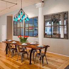 Industrial Dining Room by threshold interiors