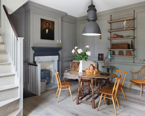 salle manger avec un po le bois et un mur gris photos et id es d co de salles manger. Black Bedroom Furniture Sets. Home Design Ideas