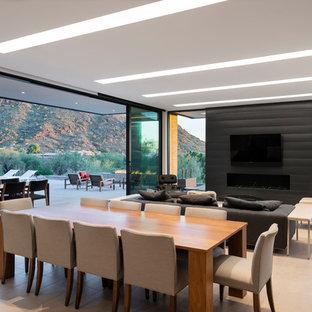Foto di una sala da pranzo aperta verso il soggiorno minimalista di medie dimensioni con pareti con effetto metallico, pavimento in gres porcellanato, camino lineare Ribbon, cornice del camino in metallo e pavimento bianco