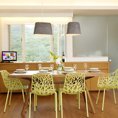 Dining room - tropical dining room idea in Hong Kong with white walls