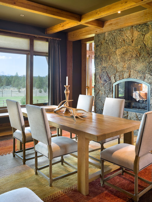 Rustic Dining Room Idea In Portland With A Two Sided Fireplace And Stone