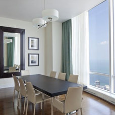 Contemporary Dining Room by M. GRACE DESIGNS, INC.
