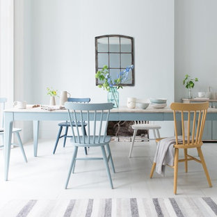Photo of a nautical dining room in London with blue walls, painted wood flooring and white floors.
