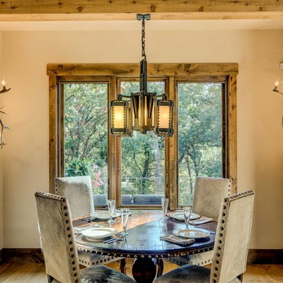 Dining room - rustic light wood floor dining room idea in Other with beige walls and no fireplace