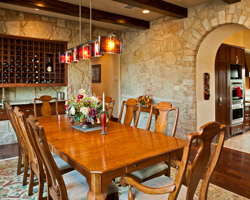 Tuscan Enclosed Dining Room Photo In Austin With Dark Wood Floors