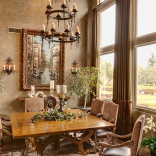 Example of a tuscan dining room design in Other with beige walls
