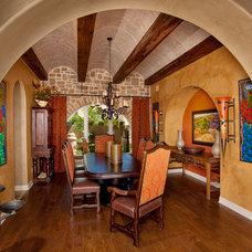 Mediterranean Dining Room by Jim Boles Custom Homes