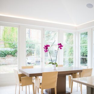 Medium Sized Classic Kitchen Dining Room In London With Limestone Flooring And Beige Floors