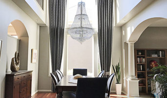 Two Story Tailored Pleat Drapes in an Elegant Dining Room