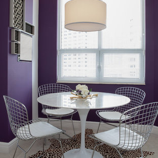 Design ideas for a contemporary dining room in Miami with purple walls.