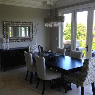 Ispirazione per una sala da pranzo aperta verso il soggiorno design di medie dimensioni con pareti beige, pavimento con piastrelle in ceramica, camino classico e cornice del camino in legno
