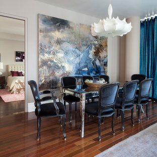 Great room - mid-sized contemporary medium tone wood floor great room idea in New York with gray walls and no fireplace