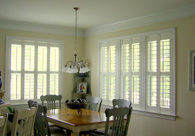 Eclectic Dining Room by Unique Perspective Blinds & Shutters