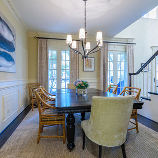Example of a large classic dark wood floor and brown floor enclosed dining room design in Dallas with beige walls and no fireplace