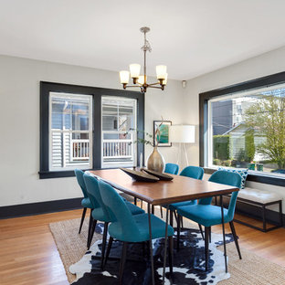 Mid Sized Transitional Medium Tone Wood Floor Enclosed Dining Room Photo In  Seattle With White
