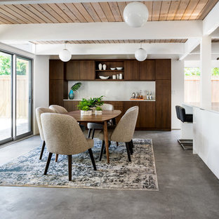 Design ideas for a mid-sized midcentury kitchen/dining combo in Portland with white walls, concrete floors and grey floor.