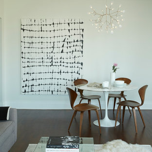 Photo of a small modern open plan dining in New York with white walls and dark hardwood floors.