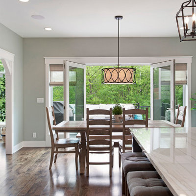 Inspiration for a mid-sized cottage dark wood floor and brown floor kitchen/dining room combo remodel in Kansas City with gray walls