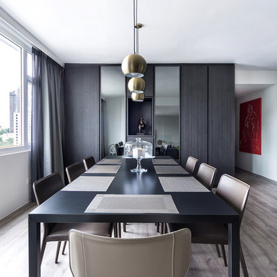 Inspiration for a contemporary dark wood floor and brown floor dining room remodel in Singapore with white walls