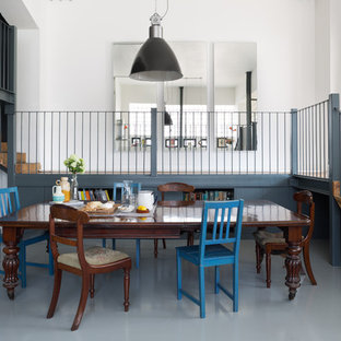 Example of a large eclectic gray floor kitchen/dining room combo design in London with white walls