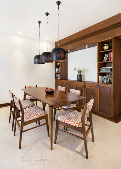 Midcentury Dining Room by We Design Studio