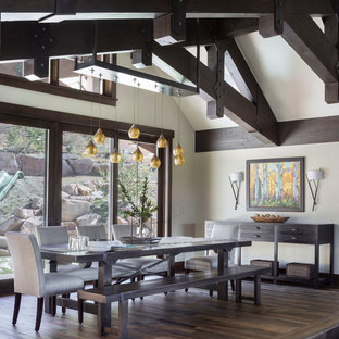 Inspiration for a large rustic medium tone wood floor and brown floor kitchen/dining room combo remodel in Denver with beige walls
