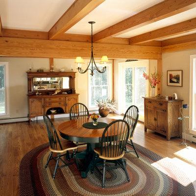 Dining room - cottage medium tone wood floor dining room idea in Boston with beige walls