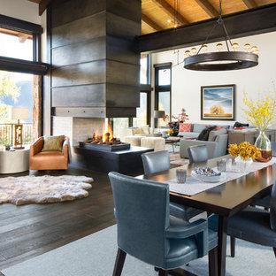 Inspiration för stora moderna matplatser med öppen planlösning, med vita väggar, mörkt trägolv, en dubbelsidig öppen spis och en spiselkrans i metall