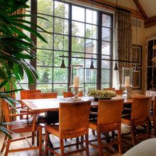 Rustic Dining Room by JLF & Associates, Inc.