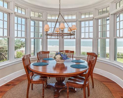 Beach Style Medium Tone Wood Floor Dining Room Idea In Atlanta With Beige  Walls