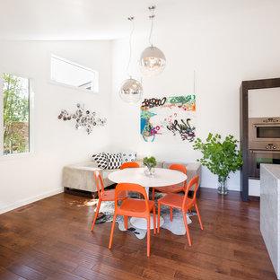 Пример оригинального дизайна: кухня-столовая в современном стиле с белыми стенами