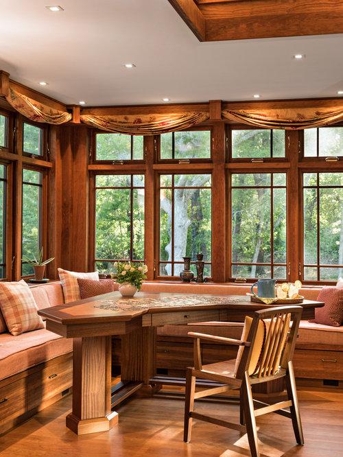 Dining room craftsman medium tone wood floor and orange floor dining room idea in boston