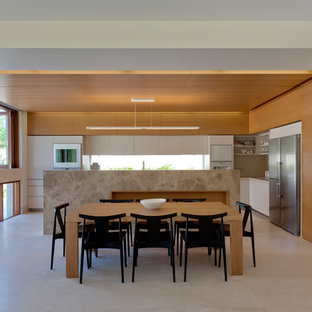 Design ideas for a contemporary open plan dining in Sydney with beige walls and beige floor.