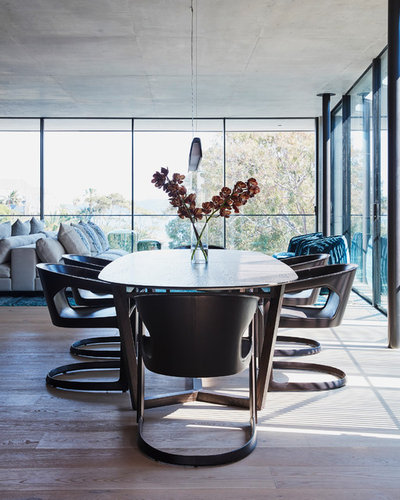 Contemporary Dining Room by Style Merchants