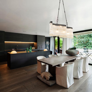 Photo of a large modern dining room in Cheshire with dark hardwood flooring and brown floors.