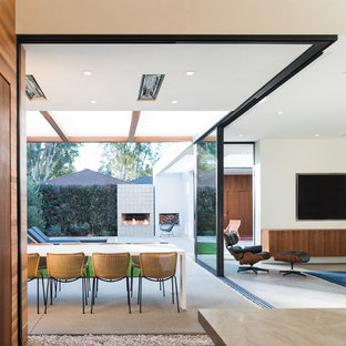 Dining room - contemporary concrete floor and gray floor dining room idea in Los Angeles with white walls